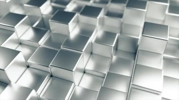 Abstraktní pozadí při náhodně se pohybujících krychlích kovů. 4k animace s plynulou smyčkou