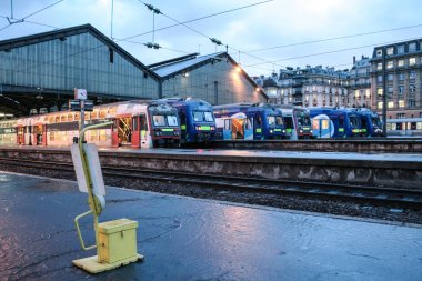 PARIS, FRANCE - JANUARY 2, 2007: Transilien Suburban trains from SNCF company ready to leave from Paris Saint Lazare Train station for a commuter service in peak transit