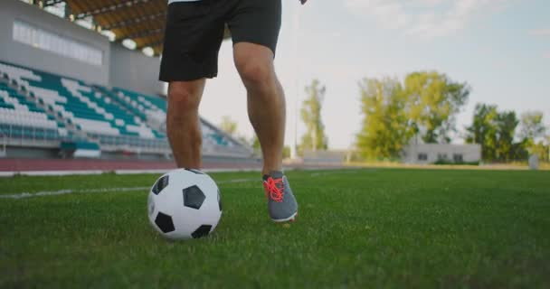 soccer player show footwork and Soccer player kicking and Shooting ball on goal in slow motion