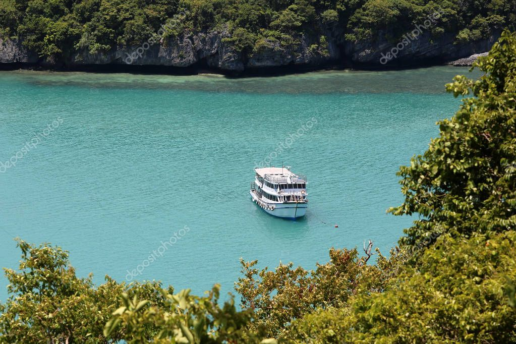 Top view on the mountain with Tour boat in the ocean background at Ang Thong archipelago in Thailand.