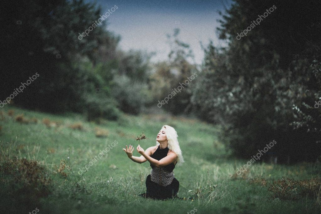 beautiful witch girl casts a spell