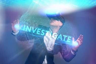 Business, Technology, Internet and network concept. Young businessman working in virtual reality glasses sees the inscription: Investigate