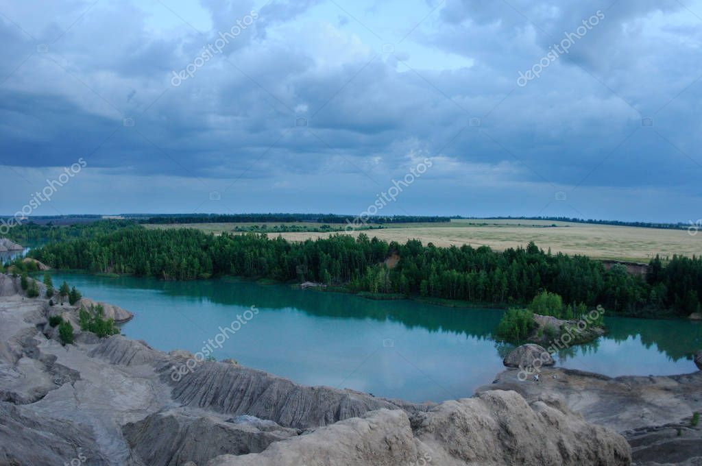 View from the top of the hill over the former brown coal open pits filled now by waters, Ushakov open pits, Tula region, Russia