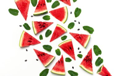 Watermelon pattern. Juicy slices of ripe red watermelon and mint leaves on white background. Flat lay, top view, copy space. Creative summer food concept