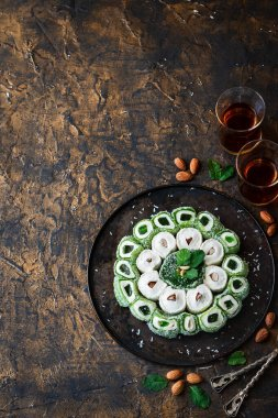 Turkish Delight. Assorted oriental sweets with nuts on a dark background.