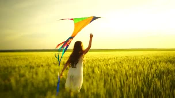girl running around with a kite on the field.