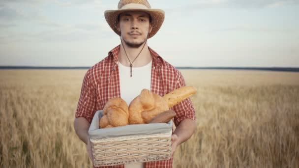 young farmer are stand along the wheat field with bread baskets