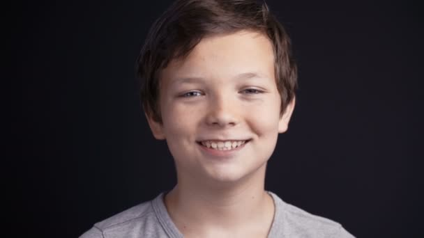 Portrait of boy looking the camera and laughing.