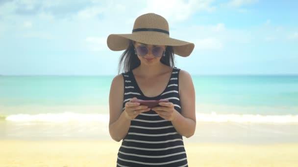traveler woman using phone app on beach at summer vacation