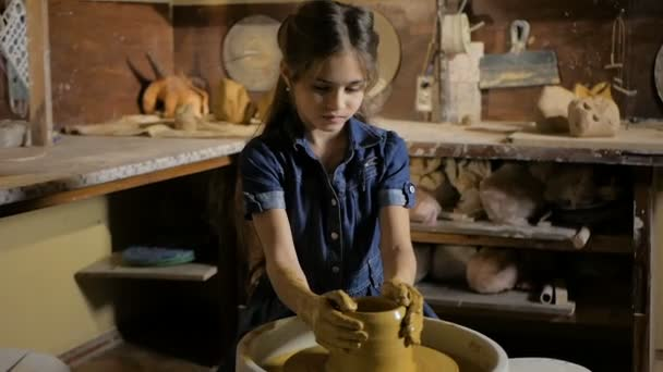 Pottery workshop. Grandpa teaches granddaughter pottery