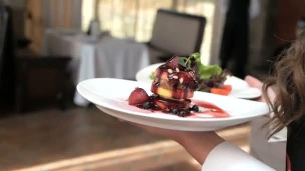 Waiter serving in motion on duty in restaurant
