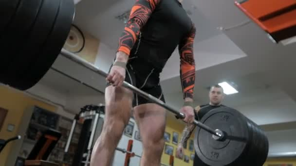 Bodybuilder pumping muscle in the gym, do fitness