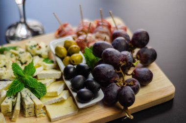 set of different cheeses on a wooden board, cheese board, delicious snack, healthy and exclusive food, cheese set