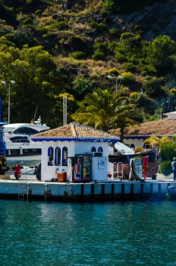 LA HERRADURA, SPAIN - MAY 26, 2018 A beautiful marina with luxury yachts and motor boats in the tourist seaside town of La Herradura
