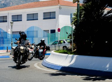 NERJA, SPAIN - JUNE 10, 2018 People and bikes on the motorcycle rally in a seaside Spanish town