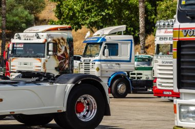 TORROX, SPAIN - JULY 22, 2018 show of tractor units for visitors, powerful machines gathered in a square in an Andalusian town