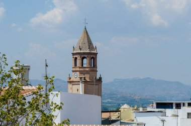 VELEZ-MALAGA, SPAIN - AUGUST 24, 2018 roofs and facades of buildings in a Spanish city, characteristic architecture in the south of Spain