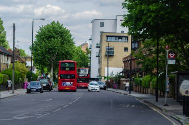 LONDON, UK - MAY 22, 2019 Red double-decker bus driving down the
