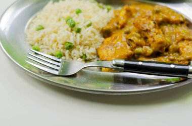 Roasted chicken breast pieces in a mildly spiced coconut curry s