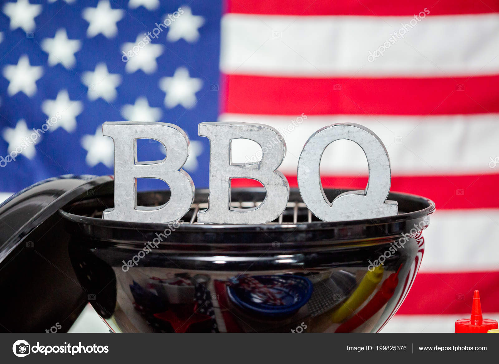 Metal Bbq Sign On Small Round Charcoal Grill With July 4th Decorations Photo By Urban Light