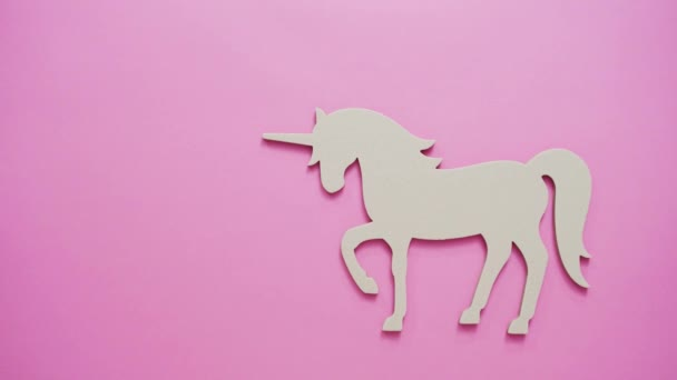 Unfinished unicorn cut out on pink background