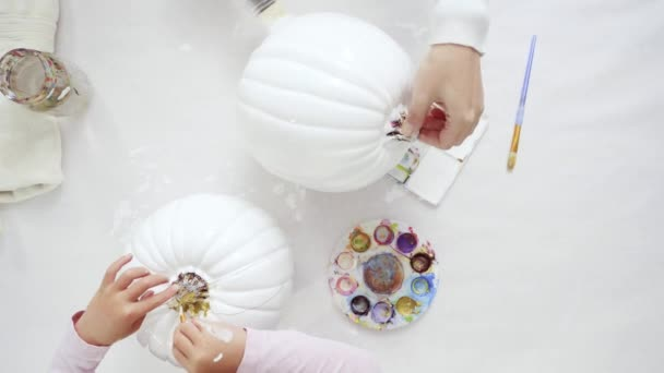 Step by step. Decorating Halloween craft pumpkin with unicorn theme