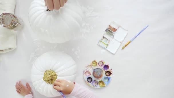 Step by step. Decorating Halloween craft pumpkin with unicorn theme