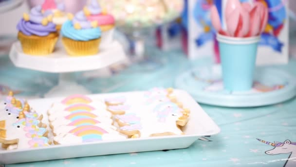 Little Girl Birthday Party Table Unicorn Cake Cupcakes Sugar Cookies Stock Footage