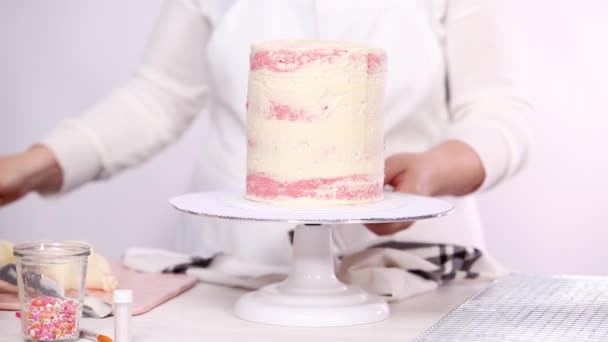 Icing Tall Birthday Cake With White Buttercream Stock Footage