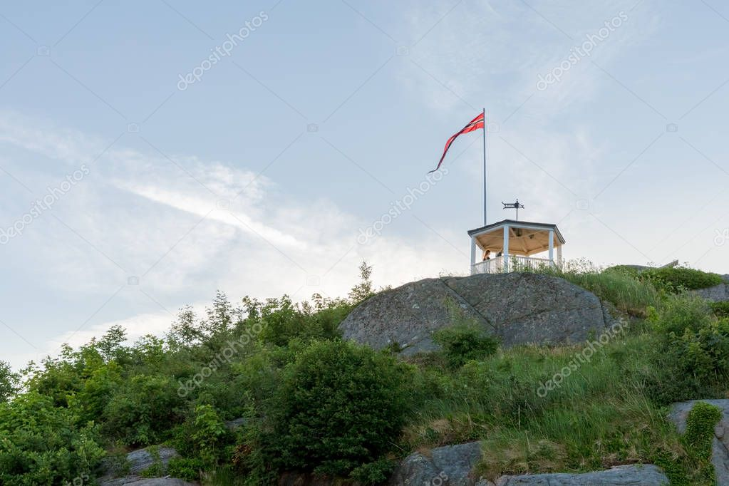 Mandal, Norway - june 2018: Uranienborg, the beautiful viewpoint in Mandal, a small city in the south of Norway. Girl standing inside pavilion, from where you can watch the city from above.