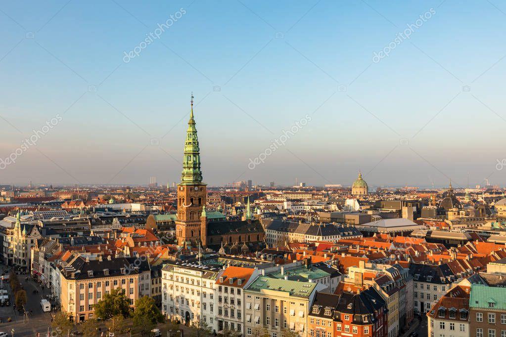 Copenhagen, Denmark - October 2018: Skyline in evening light. Copenhagen old town and copper spiel of Nikolaj Contemporary Art Center.