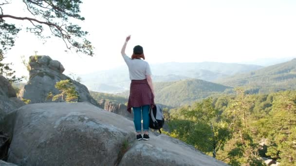 Woman with arms raised on top of mountain looking at view Hiker Girl lifting arm up celebrating scenic landscape enjoying nature vacation travel adventure.