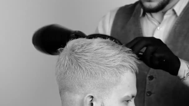 Male hairstyle in salon. Man hair drying in barber shop. Barber styling hair with dryer. Finish hairdressing. Hair dryer man in barbershop