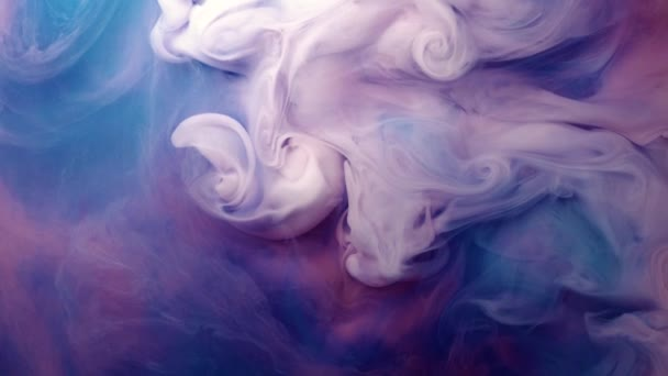 vivid colorful purple blue pink of acrylic paint drop motion texture background for abstract concept.