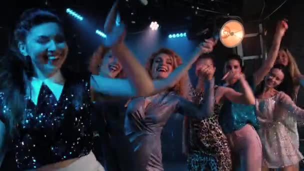 Hands up - Crowd girls partying, dancing slow motion at a night club