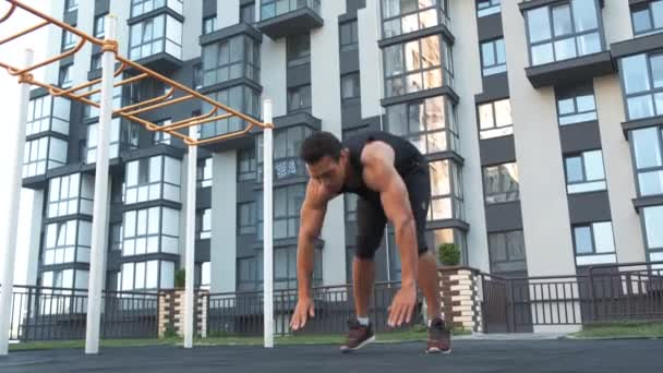 Jump Squats fitness training. Athlete Man doing Jump Squat exercise workout. Male fitness instructor training on city