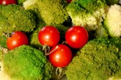 Cherry tomatoes and green broccoli. Beautiful vegetable still life for billboards.