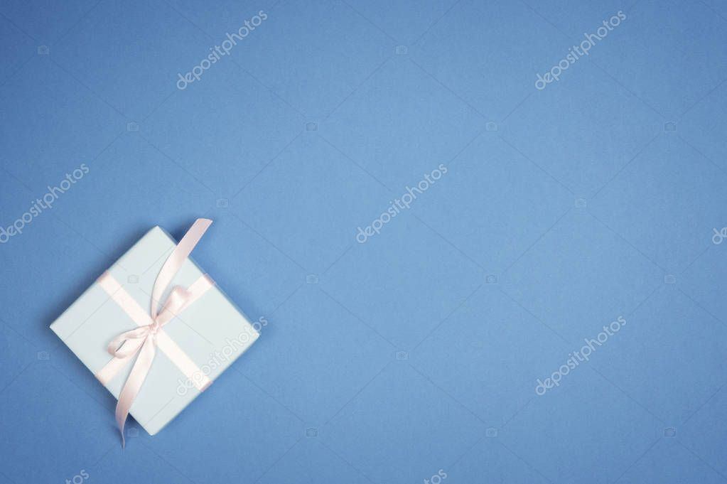 Christmas  holiday gift box,  on blue background. Flat lay