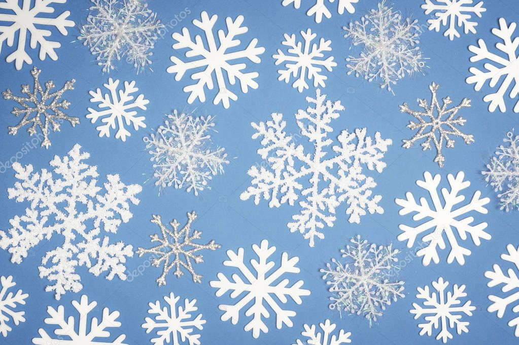 Christmas Pattern white snowflake on blue background. Top view