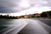 Photo silk water falls of river in the morning in Landsberg am Lech. Long exposure, artistic filters applied