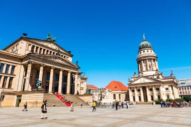 BERLIN, GERMANY - June 6, 2018: Gendarmenmarkt in the Mitte district with the French Cathedral and Schinkel's Konzerthaus.