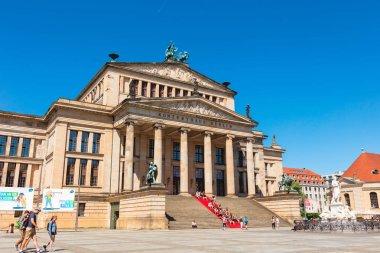BERLIN, GERMANY - June 6, 2018: Gendarmenmarkt in the Mitte district with the statue of  Friedrich Schiller and Schinkel's Konzerthaus.