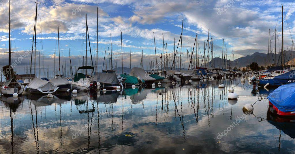 SWISS, LAKE GENEVA, 21, OCTOBER, 2017,Yachts on autumn parking lot on Lake Geneva, SWISS, LAKE GENEVA, 21, OCTOBER, 2017