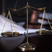 Themis scales isolated on blurred background