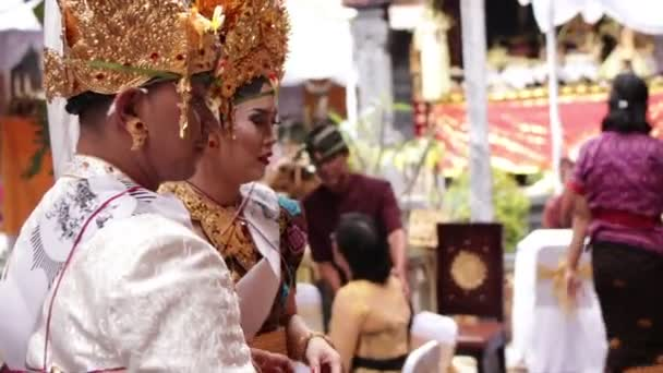BALI, INDONESIA - AUGUST 17, 2018: People on a traditional balinese wedding ceremony, Indonesia.