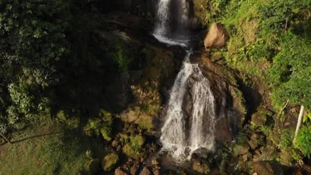 4K aerial drone footage of amazing view of waterfall in the jungle of Bali island. Sunset time in the rainforest.