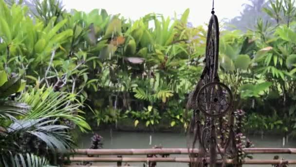 Dreamcatcher at luxury balinese villa. Raining season. Rain drops. Nature background. Bali island, Indonesia.