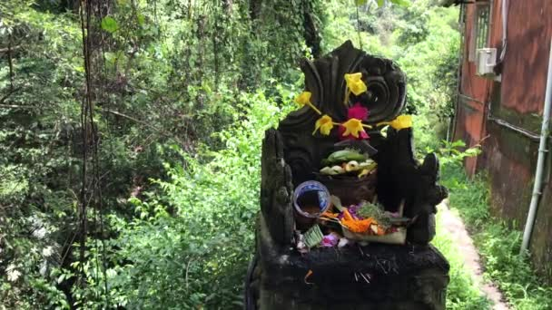 Balinese hindu altar with traditional offerings to gods. Tropical island of Bali, Indonesia.