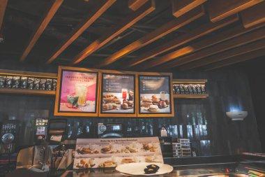 BALI, INDONESIA - FEBRAURY 19, 2019: Starbucks restaurant in the south Kuta, Bali island, Beachwalk shopping mall.