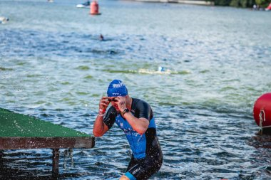 MOSCOW, RUSSIA - AUGUST 25, 2019: Ironman Swimmers on the open waters event Moscow river. Ironstar Crocus Fitness Triathlon 2019.